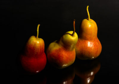 Pears on black glass