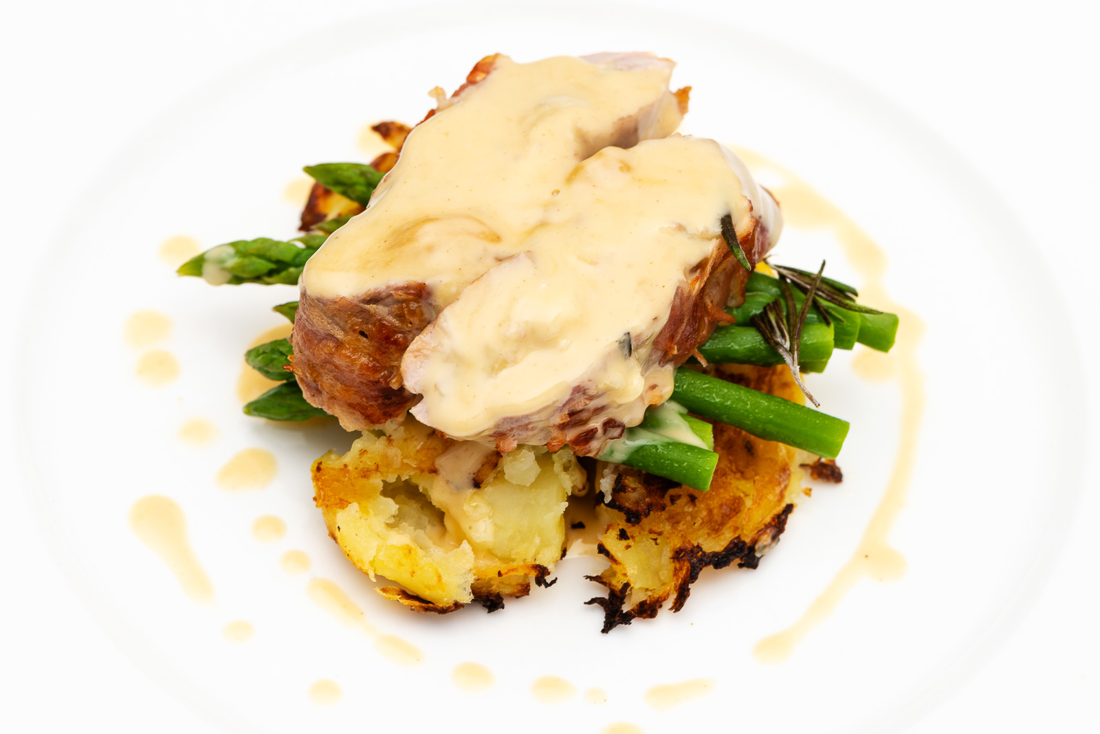 Pork Fillet with Doddington Dairy's Capability Brown Cheese, served with crispy new potatoes, asparagus and a cider sauce. Photography by Sue Todd Photography.