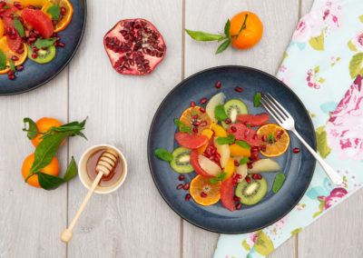 Vibrant fresh fruit, citrus, kiwi and pomegranate. Styling and photography by Sue Todd Photography
